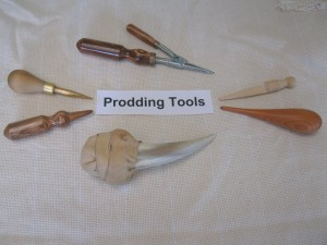 Sample Prodding Tools moving clockwise from 12 o'clock:  Bodger; Dolly Peg (one leg removed and the other sharpened slightly); turned timber; sharpened cow's horn with deerhide handle; turned timber with finger grip; Brass prodder.