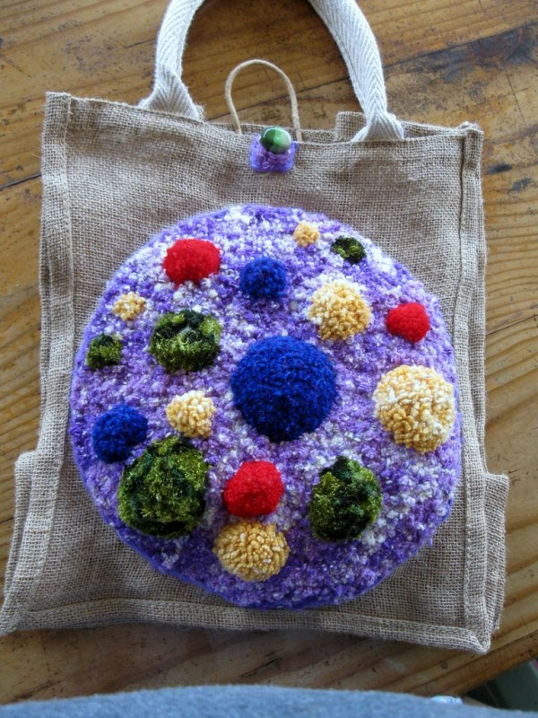 Jute bag designed and hooked by Judi Tompkins 2013.. Made with recycled wool blanket and knitting yarns; bead.