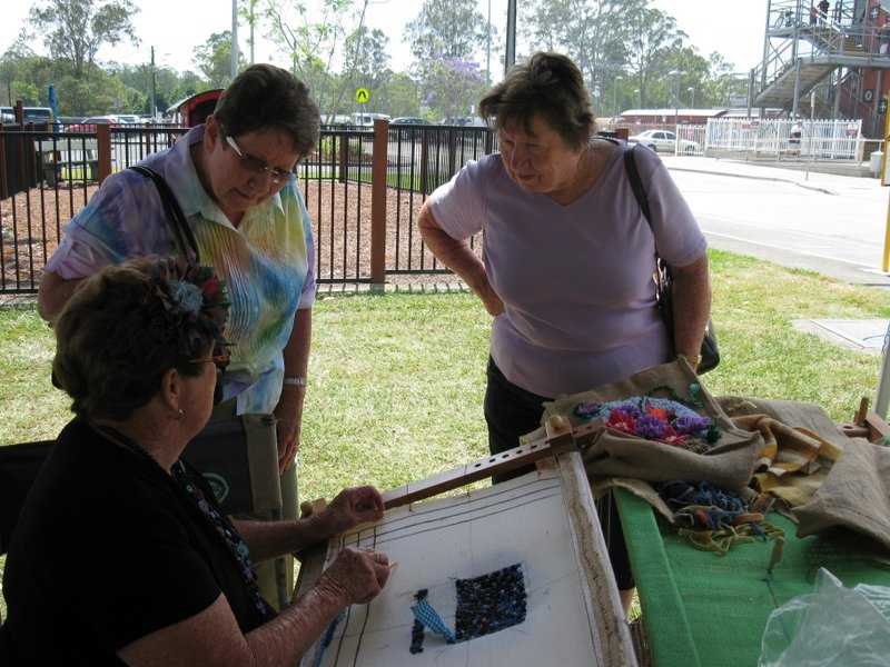 Ann demonstrating craft to visitors
