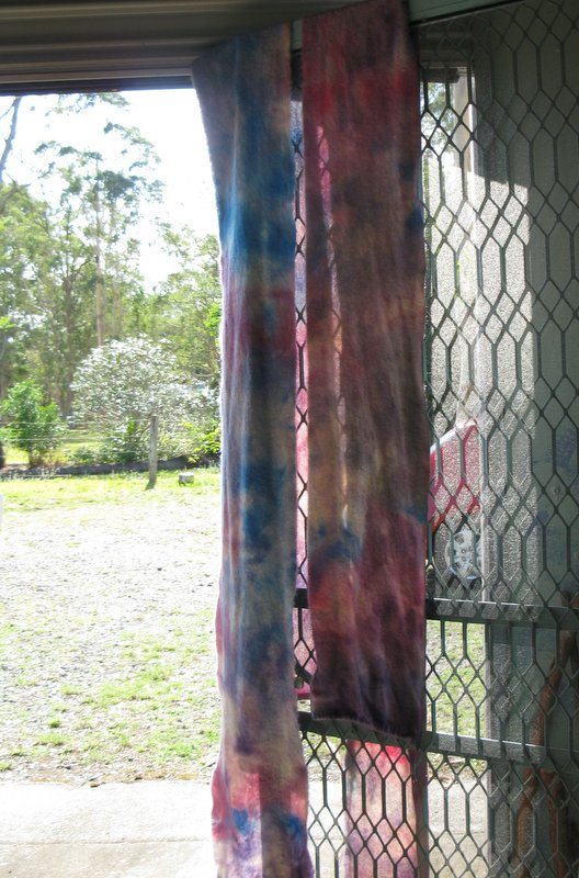 Two strips of wool blanket dyed and drying
